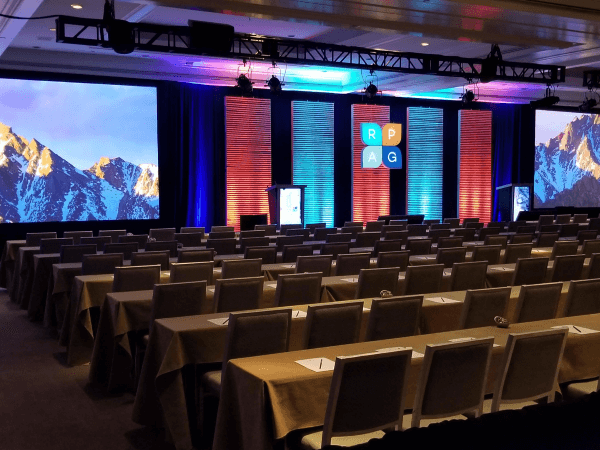 General session stage design with panels and screens