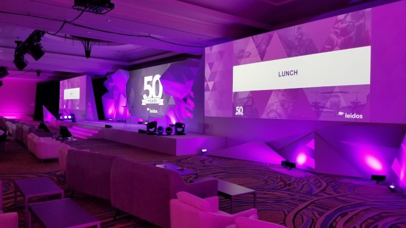 General session stage design with pink wash lighting